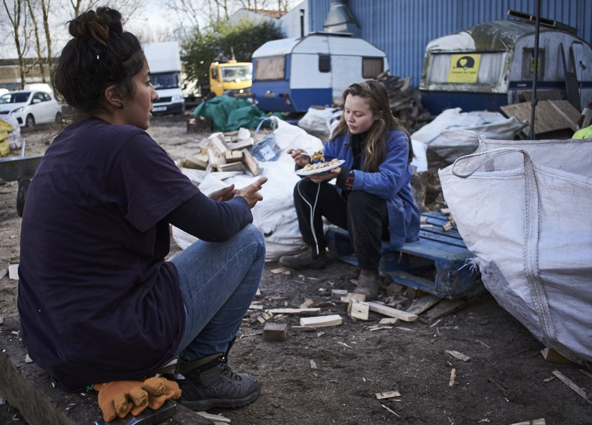 Calais charity workers breaking for lunch.