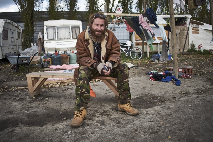French charity worker outside his caravan after a long shift.