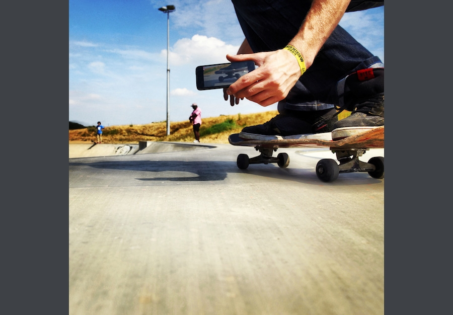 Making a video recording of skateboarding using a mobile phone.