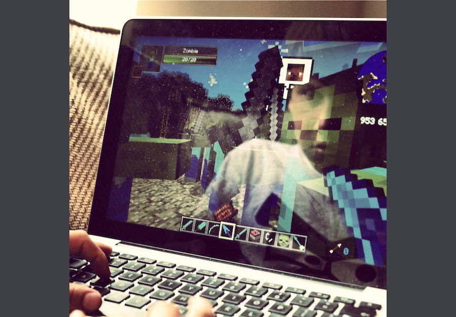 Playing a video game on a laptop.