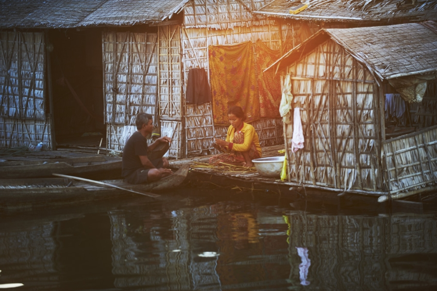 Couple communicating in floating home in Siem Reap.