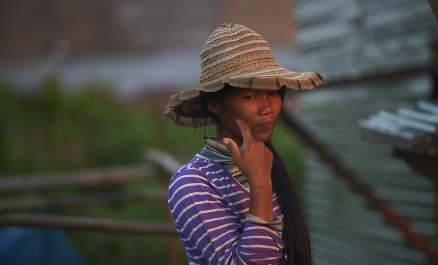 Woman wiping face in Cambodia.