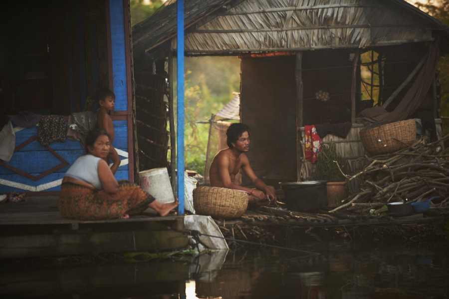 Family sitting together in floating home in Siem Reap.