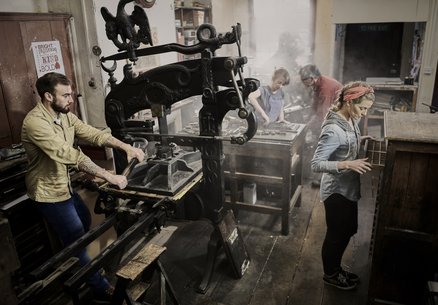 Employees at a letterpress company hard at work.