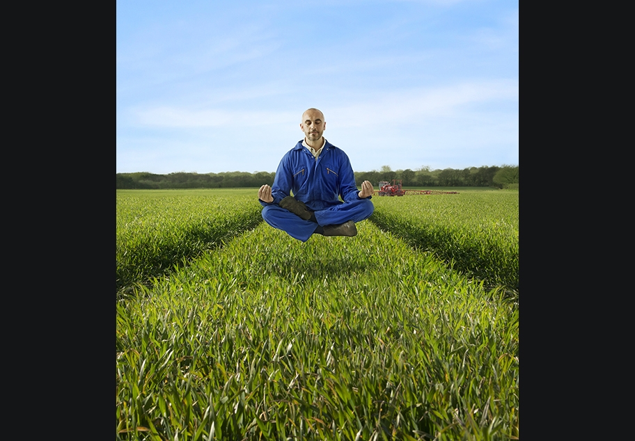 Male Farmer Meditating