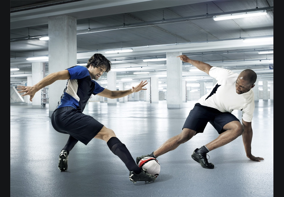 Male Footballers in underground car park