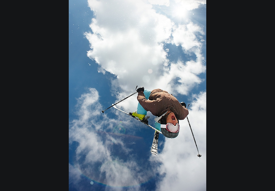 Skier performing mid air back flip