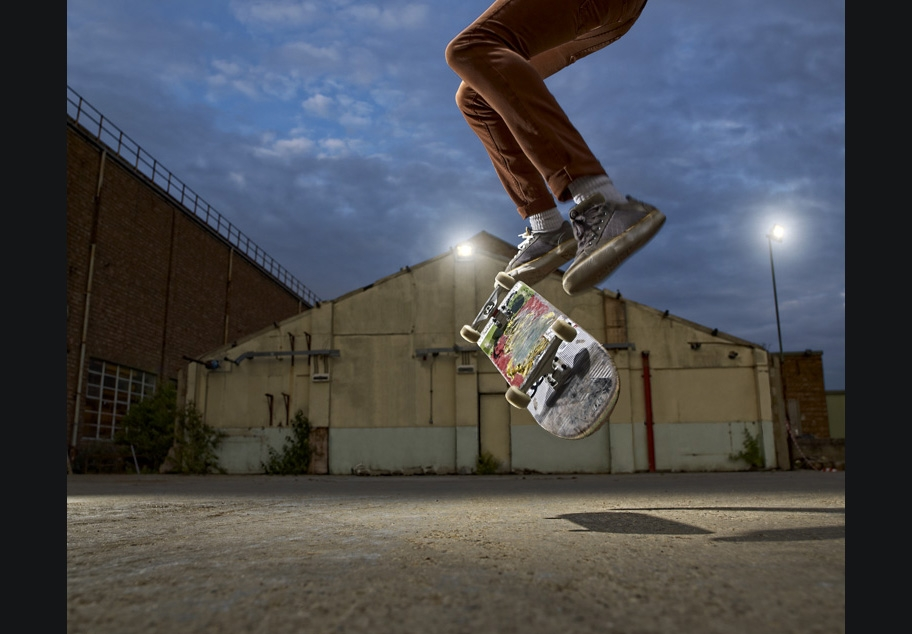 Skateboarder doing kick flip