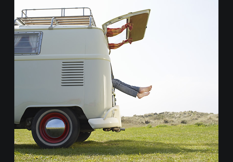 Females feet sticking out of back of Camper Van